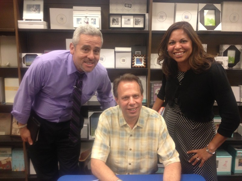Esther and I with New York Mets' broadcaster Howie Rose. My salt and pepper hair is now dyed brown.