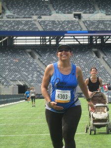 Esther finishing her last 5K race at Met Life Stadium in July.