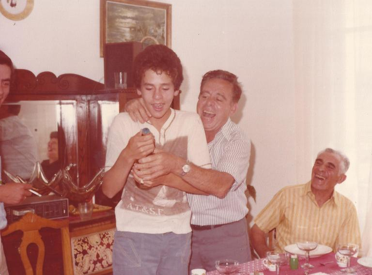 Dad helping pop a champagne cork to celebrate my 14th Birthday.