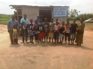 Staff and orphans outside their church