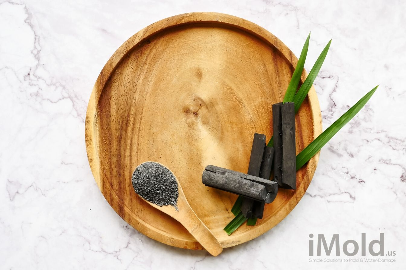 activated charcoal on a wooden spoon