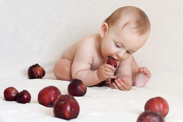 baby grabs fruit