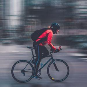 cyclist with blurred city background