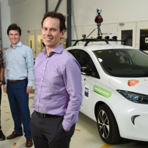 Professor Michael Milford, the Zoe 1 research vehicle, and QUT research team
