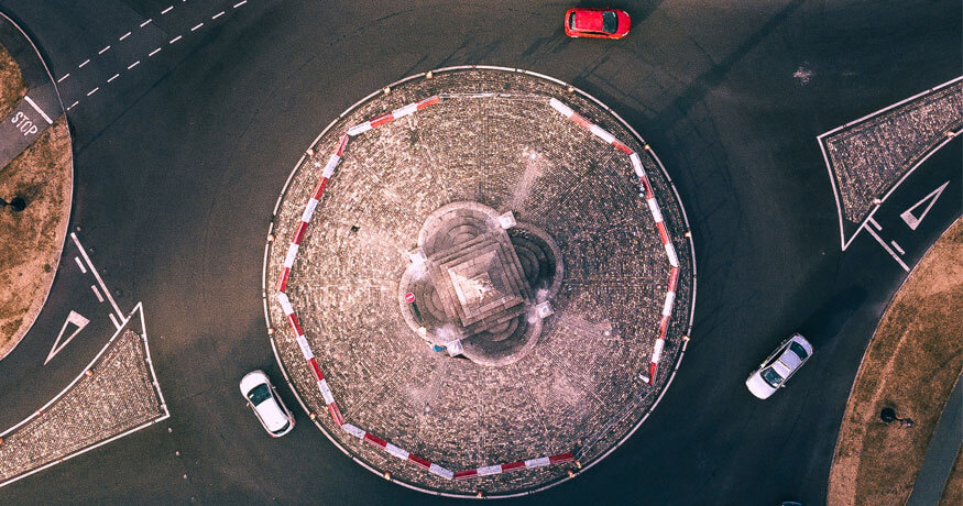 roundabout red white cars