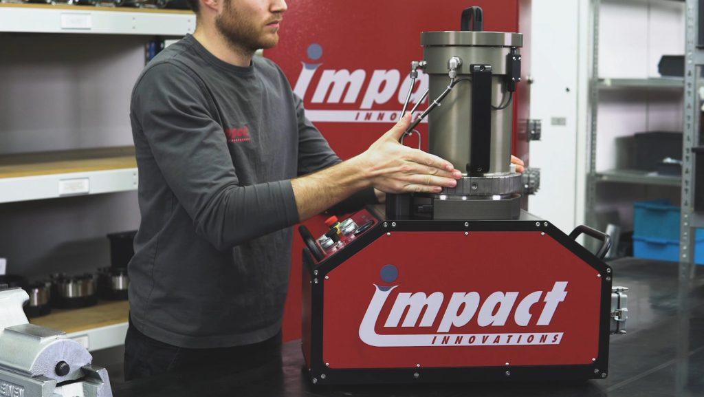 Impact Innovations Service maintenances the metal powder feeder