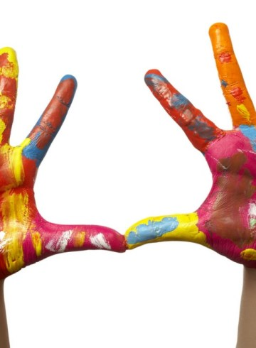 two colorfully painted hands with outstretched fingers