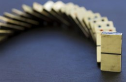 old dominoes in a line and toppled over