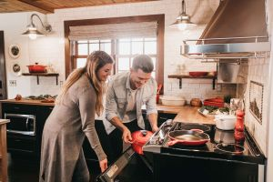 Couple with electric induction hob