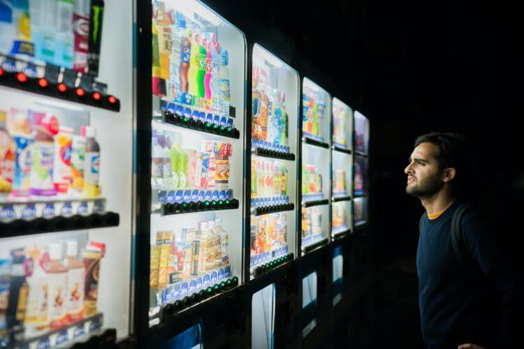 Man choosing from array of products in a chiller cabinet