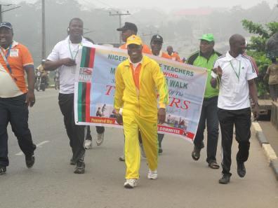 Comrade Oduguwa, NUT Chairman, Ikorodu branch leading other teachers during walk