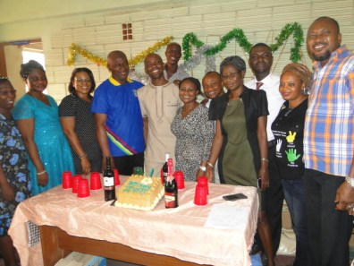 Mr Babatunde Owolabi, the celebrant (in the middle) in group photograph with staff of Local Government Education Authority, Ikorodu during the bash