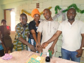 Kunle Adelabu, Publisher/Reporter-in-Chief, The Impact (first left) and others joining the celebrant ((second right on the cake table