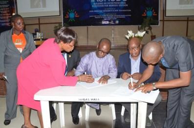 Hon. Babajimi Benson signing Memorandum of Understanding with State officials