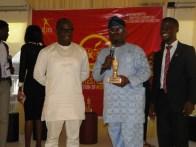 Hon. Agunbiade presenting Southwest Icon award to Hon. Benson