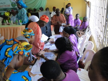 Beneficiaries regularizing their documents with the bank officials
