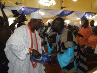 The son of he deacesed, High Onasanya in discussion with Oba Ogunsanya during the vservice