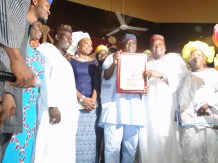 Commissioner for Commerce, Industry & Cooperatives, Prince Ogunleye and others rejoicing with Mr Erogbogbo