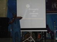 Hon Agunbiade explaining the philosophy behind the logo of Onward Movement of Nigeria