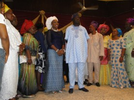 Mr Erogbogbo standing with wife and other well-wishers