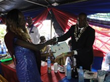 The Chairman's award for the most outstanding graduating student: Valedictorian being presented to Miss eniola Ibikunle by Prof. Noah