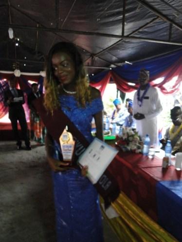 The Valedictorian, Miss Eniola Ibikunle posing with her awards