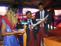 Miss Eniola Ibikunle, best graduating student and the outgoing senior girl handing-over leadership mantle on behalf of her set to the incoming senior boy and girl during the ceremony