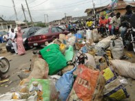 Another part of Ireshe Road being blocked with refuse by the residents protesting failure of the waste managers