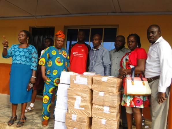 IKOGRAMS '92 with the National President donating exercise books to the Ikorodu Junior Grammar school