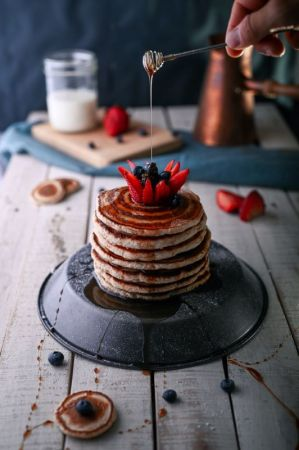 Stack of Cinnamon Pancakes with Strawberries and Syrup