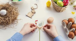Child's hands making Easter Egg biscuit