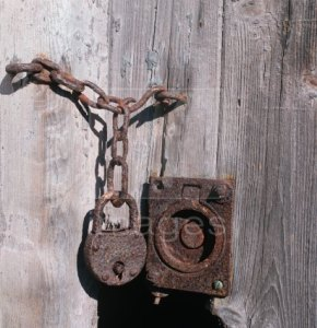 Image of a rusty old padlock on a wooden door to illustrate the Warhammer Quest Dungeon Event - Padlocked Door