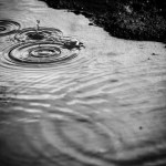 Photograph of rain drops hitting a puddle to illustrate the Warhammer Quest Settlement Event - Stinking Mire