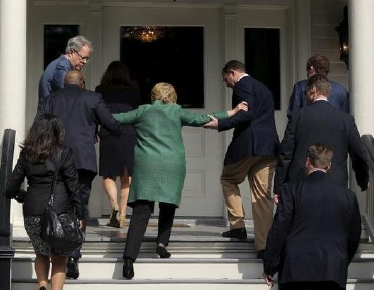 hillary-being-helped-up-stairs