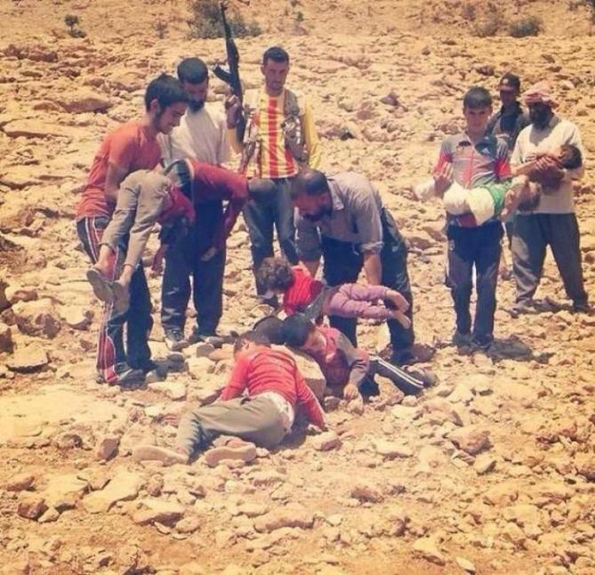 Kurdish men carry the bodies of children who died after being driven from their homes with nothing to eat or drink.
