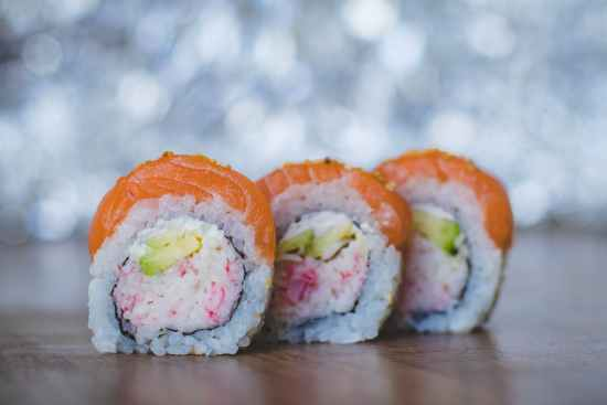 close up photo of three sushi