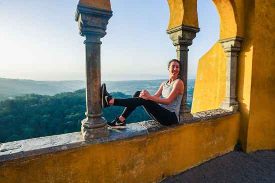 woman sitting on ledge