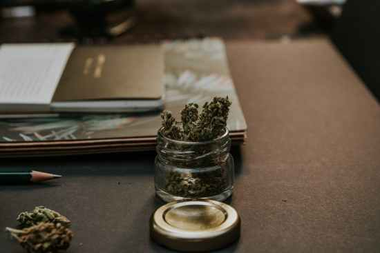 close up photo of kush on glass container