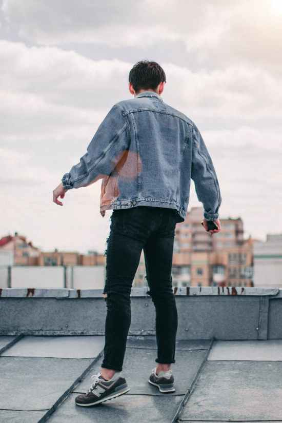 photo of a person standing on rooftop