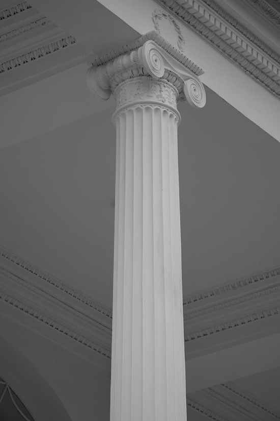 white concrete pillar in grayscale photography