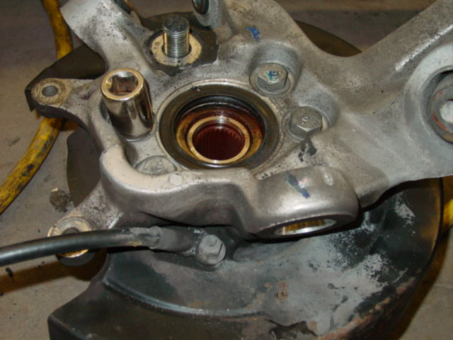 Once you have the knuckle out, you will need to change the backing plate.  This is accomplished by removing the hub/bearing assembly.