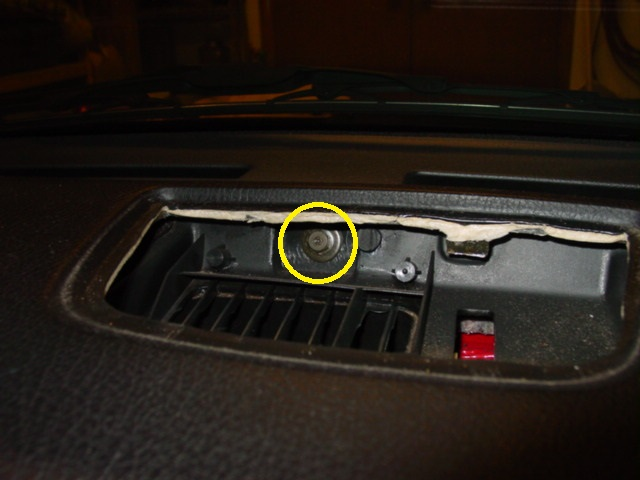 With the top vent out of the way, you can remove the single bolt that you will find.