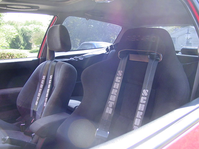 Racing harnesses do not have much to do with the suspension, but they make one of the most important upgrades. By utilizing the rear seat belts upper mount, the harness works at the proper angle for maximum safety.