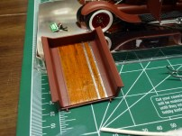 After the base color, bronze dry brushing and tamiya clear orange were applied, bare metal foil was used for the straps.