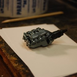 I used Testors Boyd's ice pearl paint over the black base to get the Pontiac color.