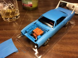 Other than the carburetor and air cleaner, the engine is complete and secured to the chassis.
