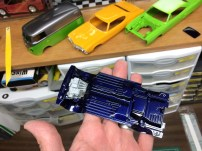 I also sprayed the chassis. Here you can see where I cut the engine out of the chassis to simplify masking.