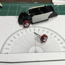 I wanted to aggressively lower the bug. To ensure the proper look, I needed to add quite a bit of camber to the rear wheels. Using a protractor, I tried to get about 5 degrees of camber.