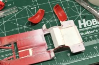 I added sheet styrene to the chassis and created a pocket for the axle.