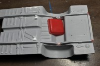 I wanted to positively and cleanly install the gas tank. In order to accomplish this, I marked the location with a pencil, drilled holes, then transferred that pattern to the tank. With pins in the tank, I can attach it from the top of the chassis.
